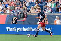 FOXBOROUGH, MA - AUGUST 18: Henry Kessler #4 of New England Revolution dribbles during a game between D.C. United and New England Revolution at Gillette Stadium on August 18, 2021 in Foxborough, Massachusetts.