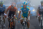 Alexander Vinokourov (KAZ) Astana approaches the summit finish of the Col du Tourmalet during a wet foggy Stage 17 of the 2010 Tour de France running 174km from Pau to Col du Tourmalet, France. 22nd July 2010.<br /> (Photo by Eoin Clarke/NEWSFILE).<br /> All photos usage must carry mandatory copyright credit (© NEWSFILE | Eoin Clarke)