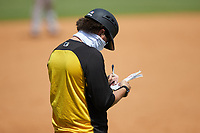 Pittsburgh Pirates scout Adam Bourassa makes notes while coaching third base during the East Coast Pro Showcase at the Hoover Met Complex on August 5, 2020 in Hoover, AL. (Brian Westerholt/Four Seam Images)