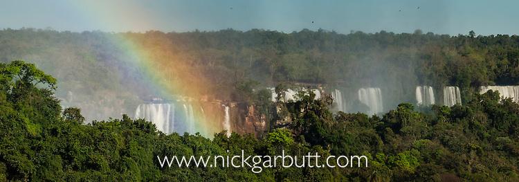 Rainbow over Iguasu Falls (also Iguazu Falls, Iguazú Falls, Iguassu Falls or Iguaçu Falls) on the Iguasu River, Brazil / Argentina border. Photographed from the Brazilian side of the Falls. State of Paraná, Brasil.