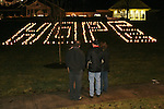 """SOUTHBURY, CT 01/01/08-010108BZ03- A few people look at the word """"HOPE"""" spelled out in luminaries on the lawn outside Sacred Heart Church in Southbury Tuesday night.   The vigil was in remembrance of youth from the area who had untimely deaths recently.<br /> Jamison C. Bazinet Republican-American"""