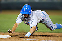 UCLA Bruin pinch runner Christoph Bono (3) dives back to first base during the eighth inning of Game 4 of the 2013 Men's College World Series against the LSU Tigers on June 16, 2013 at TD Ameritrade Park in Omaha, Nebraska. UCLA defeated LSU 2-1. (Andrew Woolley/Four Seam Images)