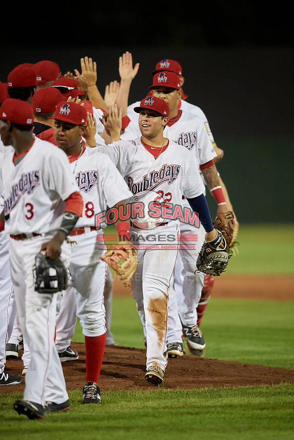Auburn Doubledays first baseman Jake Scudder (22) celebrates with his teammates after a game against the State College Spikes on August 21, 2017 at Falcon Park in Auburn, New York.  Auburn defeated State College 6-1.  (Mike Janes/Four Seam Images)