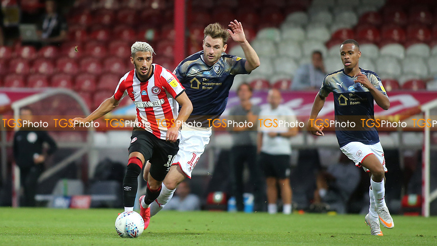 Said Benrahma of Brentford takes the ball past Barnsley's Michael Sollbauer during Brentford vs Barnsley, Sky Bet EFL Championship Football at Griffin Park on 22nd July 2020
