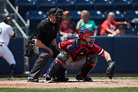 Rochester Red Wings catcher Jakson Reetz (15) sets a target as home plate umpire Jacob Metz looks on during the game against the Scranton/Wilkes-Barre RailRiders at PNC Field on July 25, 2021 in Moosic, Pennsylvania. (Brian Westerholt/Four Seam Images)