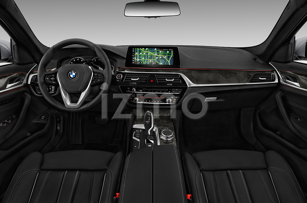 Stock photo of straight dashboard view of a 2019 BMW 5 Series 540i Sport Line 4 Door Sedan