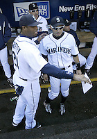 04 October 2009: (left) Ken Griffey Jr tells (right) Ichiro Suzuki that the manager wants him on the field before the game to meet a fan. Seattle won 4-3 over the Texas Rangers at Safeco Field in Seattle, Washington.