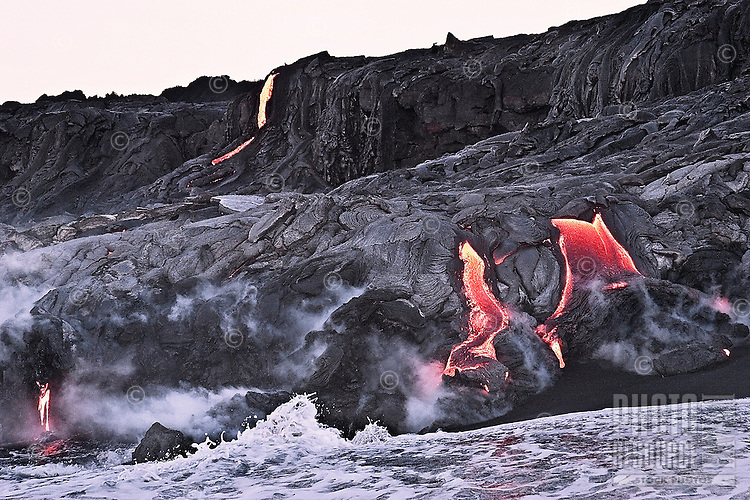 Lava from Kilauea volcano flowing into the ocean at Hawaii Volcanoes National Park on the Big Island.