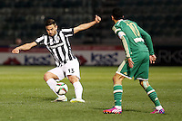 """Pictured: Sotiris Papagiannopoulos (L), when he played for PAOK Salonika in Greece. STOCK PICTURE<br /> Re: Swedish centre-back Sotiris Papagiannopoulos is joining Premier League side Swansea City for a trial.<br /> The 26-year-old is contracted to Swedish club Ostersunds FK, so could only sign for the Swans when the transfer window reopens in January.<br /> Swansea say Stockholm-born Papagiannopoulos will train with them for """"a few days"""".<br /> The club have a working relationship with Ostersunds, having signed forward Modou Barrow from them in 2014."""
