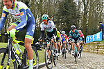 The peloton including Daniel Oss (ITA) Bora-Hansgrohe summit the Muur van Geraardsbergen during the 76th edition of Omloop Het Nieuwsblad 2021 running 200km from Gent to Ninove, Belgium. 27th February 2021  <br /> Picture: Serge Waldbillig | Cyclefile<br /> <br /> All photos usage must carry mandatory copyright credit (© Cyclefile | Serge Waldbillig)