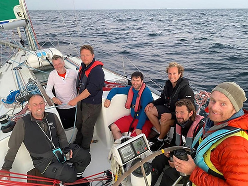 Happy campers. The Fastnet Race trainees aboard Irish Offshore Sailing's Desert Star (with skipper Ronan O Siochru on right, and Conor Totterdell third from right) got themselves the bargain of a lifetime in buying into the 2021 programme. Photo courtesy IOS