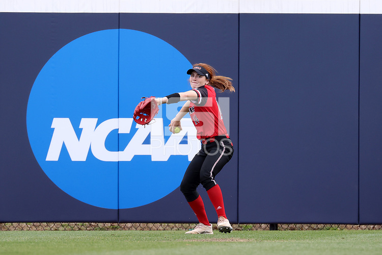 GREENSBORO, NC - MARCH 11: Kira Mickelson #14 of Northern Illinois University throws the ball during a game between Northern Illinois and UNC Greensboro at UNCG Softball Stadium on March 11, 2020 in Greensboro, North Carolina.