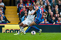 Sun 22 September 2013<br /> <br /> Pictured:Wayne Routledge of Swansea and Dean Moxeyp of Crystal Palace<br /> <br /> Re: Barclays Premier League Crystal Palace FC  v Swansea City FC  at Selhurst Park, London