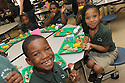 Children from New Orleans College Prep enjoy corn on the cob, baked fish and roasted potatoes at lunch, prepared by Liberty Kitchen, New Orleans, March 23, 2012.