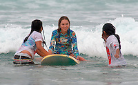 Saturday, August 23 2008.  Julian Hasley, (13) works with a couple of girls during the 22nd Annual Kids Day hosted by the Windansea Surf Club at La Jolla Shores.  Hasley is the grandaughter of Chuck Hasley, one of the original surfers who founded the club in 1963.