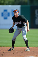 First baseman Pavin Smith (24) of Palm Beach Gardens in Jupiter, Florida playing for the Colorado Rockies scout team during the East Coast Pro Showcase on August 2, 2013 at NBT Bank Stadium in Syracuse, New York.  (Mike Janes/Four Seam Images)