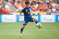 June 23, 2015: Saori ARIYOSHI of Japan controls the ball during a round of 16 match between Japan and Netherlands at the FIFA Women's World Cup Canada 2015 at BC Place Stadium on 23 June 2015 in Vancouver, Canada. Japan won 2-1. Sydney Low/AsteriskImages.com