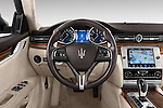 Car pictures of steering wheel view of a 2014 Maserati Quattroporte SQ4 4 Door Sedan Steering Wheel