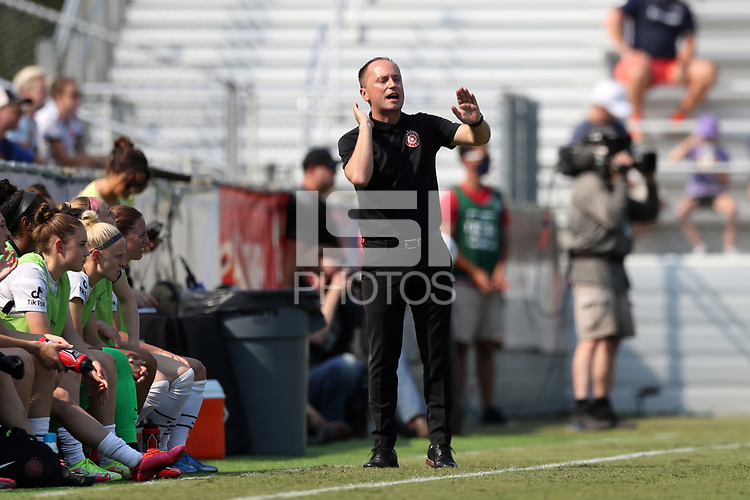 CARY, NC - SEPTEMBER 12: Head coach Mark Parsons yells instructions to his team from the bench during a game between Portland Thorns FC and North Carolina Courage at Sahlen's Stadium at WakeMed Soccer Park on September 12, 2021 in Cary, North Carolina.