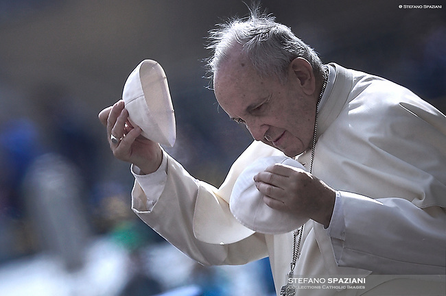 At the general audience on Wednesday in St. Peter's Square Pope Francis changes his zucchetto (skullcap)  with a young pilgrim.June 13, 2018