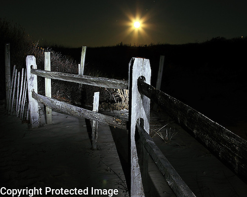 Visions and sights from a late night walk on Long Beach Island.  Moon rise viewed from a trail leading to the beach on a winter's night.  Nocturnal fine art photography.  Available as a Limited edition Fine Art Print printed to conservation standards by a Master Printer specializing in gallery/museum archival prints.