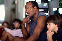 LOS ANGELES, CA - Former Cleveland Browns great Jim Brown hangs out in his home in Los Angeles, California in 1991. Photo by Brad Mangin
