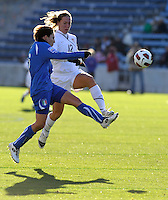US forward Lauren Cheney (12) battles for the ball with Italian defender Laura Neboli (6).  The U.S. Women's National Team defeated Italy 1-0 at Toyota Park in Bridgeview, IL on November 27, 2010 to advance to the Women's World Cup in Germany.