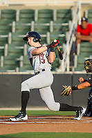 Ryan Cordell (13) of the Hickory Crawdads follows through on his swing against the Kannapolis Intimidators at CMC-Northeast Stadium on May 19, 2014 in Kannapolis, North Carolina.  The Crawdads defeated the Intimidators 10-6.  (Brian Westerholt/Four Seam Images)
