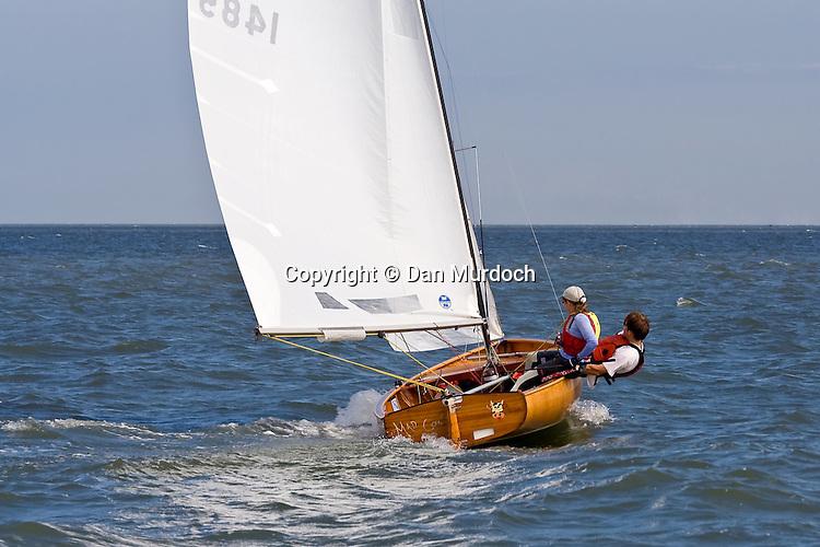 2 young adults enjoying a sail