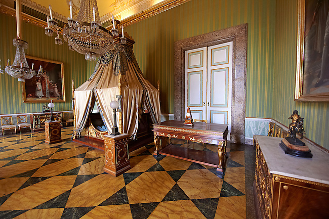 """""""The bedroom of Joachim Murat""""  is decorated in the Empire style and comes from the Royal Palace of Portici, the favourite palace of  Joachim Murat and Caroline Bonaparte. The bed is mahogany designed by French Architedt Leconte.  On the wall is a portrait of Julia Clary and her daughters.  The Bourbon Kings of Naples Royal Palace of Caserta, Italy."""
