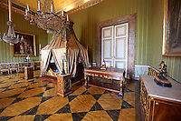 """The bedroom of Joachim Murat""  is decorated in the Empire style and comes from the Royal Palace of Portici, the favourite palace of  Joachim Murat and Caroline Bonaparte. The bed is mahogany designed by French Architedt Leconte.  On the wall is a portrait of Julia Clary and her daughters.  The Bourbon Kings of Naples Royal Palace of Caserta, Italy."