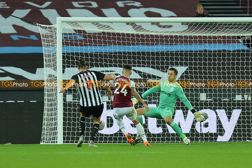 Ryan Fredericks of West Ham United gets to the ball a head of Andy Carroll of Newcastle United during West Ham United vs Newcastle United, Premier League Football at The London Stadium on 12th September 2020