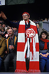 Welsh rugby fan with huge home made knitted red and white scarf at Rugby match at Twickenham London England  1980s