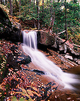 A scenic waterfall along Oliverian Brook in autumn in the White Mountain National Forest. New Hampshire.