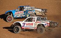 Nov. 6, 2010; Las Vegas, NV USA; LOORRS pro two unlimited driver Robby Woods (99) races alongside Carl Renezeder (17) during round 13 at the Las Vegas Motor Speedway short course. Mandatory Credit: Mark J. Rebilas-