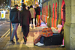 © Joel Goodman - 07973 332324 . Manchester , UK . 05/04/2015 . A man with a dog sitting in a sofa chair on Sackville Street , in Manchester City Centre . Revellers on a Saturday night out during the Easter Bank Holiday weekend . Photo credit : Joel Goodman