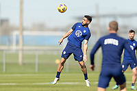 BRADENTON, FL - JANUARY 19: Cristian Roldan wins the header during a training session at IMG Academy on January 19, 2021 in Bradenton, Florida.