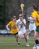 Boston College defender Kate Collins (6) brings the ball forward as University of Vermont attacker Allison Pfohl (8) closes. Boston College defeated University of Vermont, 15-9, at Newton Campus Field, April 4, 2012.