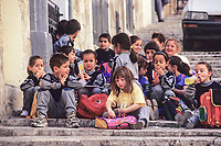 Valletta, Malta.  Maltese School Children Awaiting Entry to a Museum.  Boys and Girls.