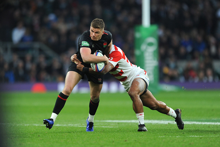 Owen Farrell of England looks to offload as he is tackled by Timothy Lafaele of Japan during the Quilter International match between England and Japan at Twickenham Stadium on Saturday 17th November 2018 (Photo by Rob Munro/Stewart Communications)