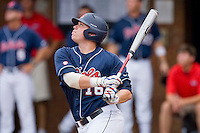 Matt Smith #16 of the Ole Miss Rebels follows through on his swing against the Virginia Cavaliers at the Charlottesville Regional of the 2010 College World Series at Davenport Field on June 5, 2010, in Charlottesville, Virginia.  The Cavaliers defeated the Rebels 13-7.  Photo by Brian Westerholt / Four Seam Images