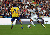 Saturday 28 September 2013<br /> Pictured: Jonathan de Guzman of Swansea (R) against Mathieu Flamini of Arsenal (L)<br /> Re: Barclay's Premier League, Swansea City FC v Arsenal at the Liberty Stadium, south Wales.