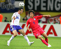 Willy Sagnol (19) of France and Jung Hwan Ahn (9) of the Korea Republic.The Korea Republic and France played to a 1-1 tie in their FIFA World Cup Group G match at the Zentralstadion, Leipzig, Germany, June 18, 2006.