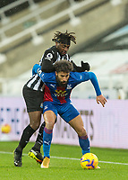 2nd February 2021; St James Park, Newcastle, Tyne and Wear, England; English Premier League Football, Newcastle United versus Crystal Palace; Andros Townsend of Crystal Palace  shields the ball from Allan Saint-Maximin of Newcastle United