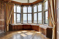 BNPS.co.uk (01202 558833)<br /> Pic: Savills/BNPS<br /> <br /> Pictured: A bay window inside the castle.<br /> <br /> A stunning historic castle with views across the Channel to France is on the market for £11m.<br /> <br /> Grade I Listed Lympne Castle dates back to the 13th century and hosted everyone from archbishops and prime ministers to celebrities including Mick Jagger and Sir Paul McCartney.<br /> <br /> The striking property in Hythe, Kent, has such incredible views it was used during the Second World War to spot V1 rockets in Calais on a clear day, allowing coastline guns to be ready to shoot down the rockets over Hythe Bay.<br /> <br /> The grand home, which has been run as a wedding and events venue for the past 20 years, is on the market with Savills.