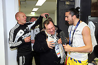 Pictured: Swansea City FC chaplain Kevin Johns (C) has beer poured over his head by goalkeeping coach Adrian Tucker (L) while interviewing Chico Flores (R) in the changing room after the game. Sunday 24 February 2013<br /> Re: Capital One Cup football final, Swansea v Bradford at the Wembley Stadium in London.