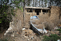 An abandoned boat in a village in Hebei Province, China. The area has been ravaged by desertification. Desertification is the process by which fertile land becomes desert, typically as a result of drought, deforestation, or inappropriate agriculture. 41 % of China's landmass in classified as arid or desert. Inappropriate farming methods and over cultivation have contributed to the spreading of deserts in China in recent years.