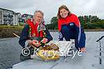 Dr Noel Mulligan showing Heidi Giles of the Tralee Rowing club, colonies of the Australian Tubeworm found in the canal an Ecological Investigation of the Tralee Ship Canal,
