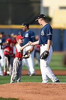 Lake County Captains pitcher Robbie Aviles (11) fist bumps a young fan who got to take the field with him before a game against the Dayton Dragons on June 7, 2014 at Classic Park in Eastlake, Ohio.  Lake County defeated Dayton 4-3.  (Mike Janes/Four Seam Images)