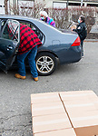 TORRINGTON, CT-011221JS06- Volunteers load boxes of food info a vehicle during a food giveaway Tuesday at Major Besse Park in Torrington. The event is hosted by the First Congregational Church of Torrington and is held the second Tuesday of each month. They he church has been holding the he giveaway for more than 10 years. <br /> Jim Shannon Republican-American